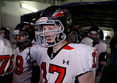 The Loveland Indians DL Michael Teesdale #17 waits with his team to come out of the tunnel to play the Windsor Wizards for the 2015 4A Colorado State...