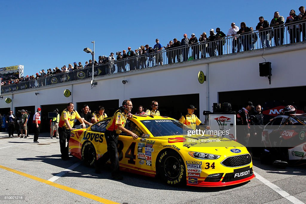 The #34 Love's Travel Stops Ford, driven by Chris Buescher (not pictured), is pushed by crew members through the garage area during practice for the NASCAR Sprint Cup Series Daytona 500 at Daytona International Speedway on February 13, 2016 in Daytona Beach, Florida.