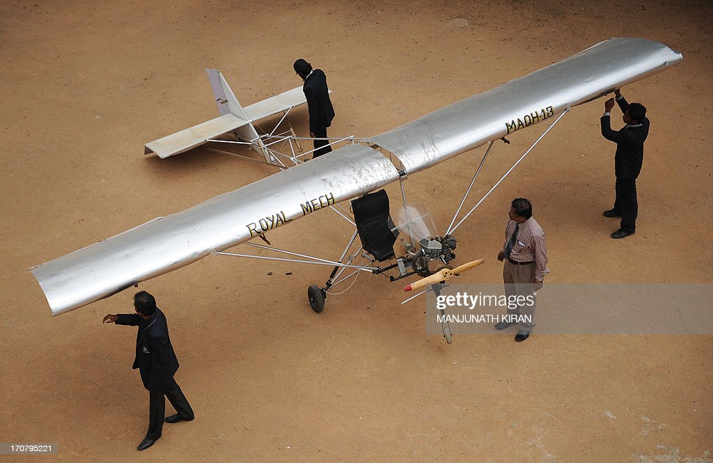 The low cost manned microlight aircraft (MAQH 13), developed by Mohammed Muzakkir Sharieff and his project teammates of the Mechanical Engineering Department, is pictured on the HKBK College of Engineering premises in Bangalore on June 18, 2013. The microlight aircraft, made to fly a payload of 200 kilograms, was designed and developed by a 4-member team as part of their ongoing final year project with a total cost of 45,000 rupees (USD 780). It is powered by a modified 150cc motorcycle engine with a wingspan of 24 feet (7.2 meters) and 17 feet (5.15 meters). Once completed the aircraft will undergo airworthiness tests after obtaining clearance and certification from the Director General for Civil Aviation (DGCA). AFP PHOTO/Manjunath KIRAN
