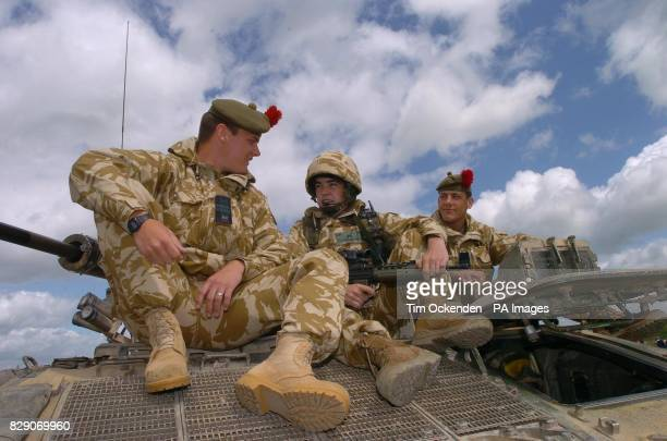 Barry Craig and Paul from Fife members of the 1st Battalion The Black Watch relax during a training exercise on Salisbury Plain before the...