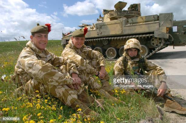 Paul Barry and Craig from Fife members of the 1st Battalion The Black Watch relax during a training exercise on Salisbury Plain before the...