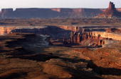 The Lower Basins Zone is outlined by the white rim edge as seen from the Murphy Campsite on the White Rim Trail on October 26 2007 in Canyonlands...