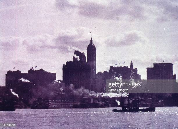 The Lower Manhattan skyline with tug boats in the foreground Photo by Alfred Stieglitz