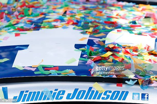 The Lowe's Pro Services Chevrolet driven by Jimmie Johnson is seen covered in confetti in Victory Lane after his win in the NASCAR Sprint Cup Series...