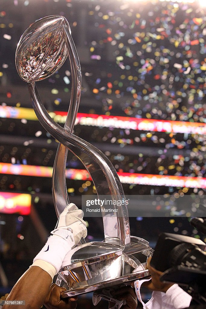 The LSU Tigers hold the Cotton Bowl Championship trophy while celebrating a 41-24 win against the Texas A&M Aggies during the AT&T Cotton Bowl at Cowboys Stadium on January 7, 2011 in Arlington, Texas.