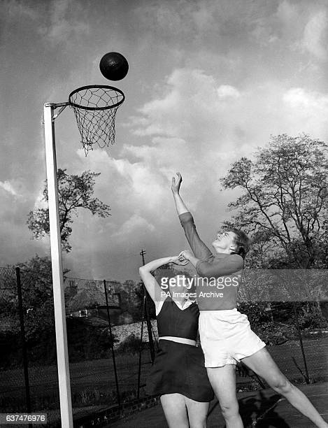The LTE Captain Pat Hatfield gets the ball in the net in spite of an acrobatic attempt to prevent her by the Exiles Captain Eileen Burchett