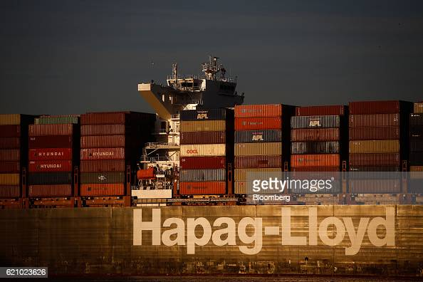 The Ludwigshafen Express container vessel operated by HapagLloyd AG sits dockside at the container terminal operated by DP World Ltd at the Port of...