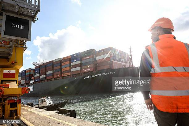The Ludwigshafen Express container vessel operated by HapagLloyd AG stands sails into the dock at the container terminal operated by DP World Ltd at...