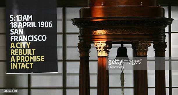 The Lutine bell hangs in the Lloyd's of London underwriting room near a banner marking the centenary of the 1906 San Francisco earthquake at Lloyd's...