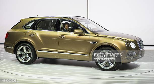 The luxury SUV Bentley Bentayga car is presented during the Volkswagen group night at the Fraport arena prior to the 66th IAA auto show in Frankfurt...