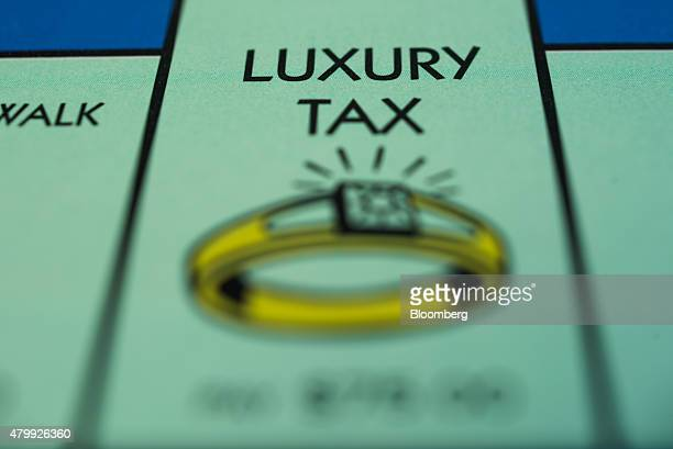 The 'Luxury Tax' square is seen on a Hasbro Inc Monopoly board game arranged for a photograph taken with a tiltshift lens in Oradell New Jersey US on...