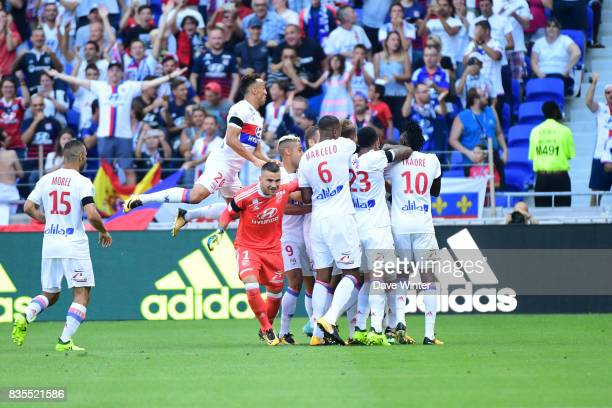 The Lyon team celebrate the goal scored from the halfway line by Nabil Fekir of Lyon during the Ligue 1 match between Olympique Lyonnais and FC...