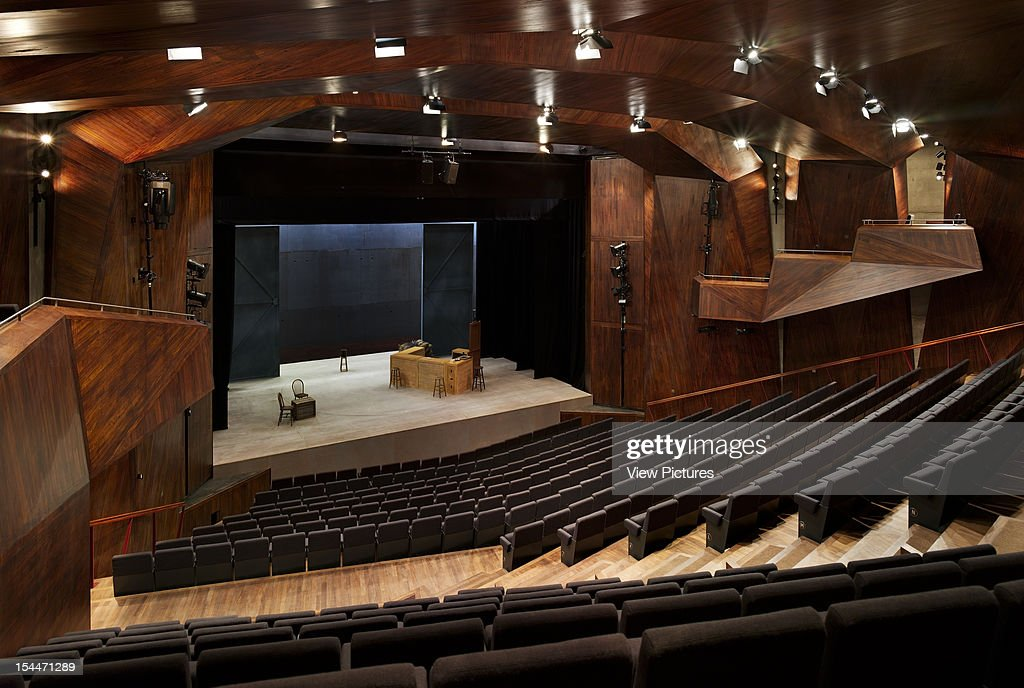 The Lyric Theatre, O'Donnell And Tuomey, Belfast, Northern Ireland, 2011, Elevated View Of Auditorium With Assymetric Aisles, Faceted Wood Panels And Stage Set, Odonnell And Tuomey, United Kingdom, Architect,