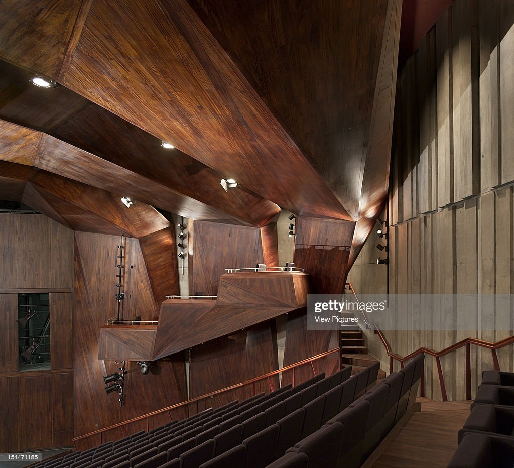 The Lyric Theatre, O'Donnell And Tuomey, Belfast, Northern Ireland, 2011, Auditorium Interior With Faceted Wood And Seating, Odonnell And Tuomey, United Kingdom, Architect,