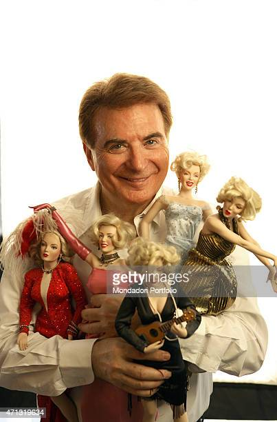 The lyricist and TV presenter Paolo Limiti posing for a photo shooting in his house in Milan with his famous actresses dolls collection Milan Italy...