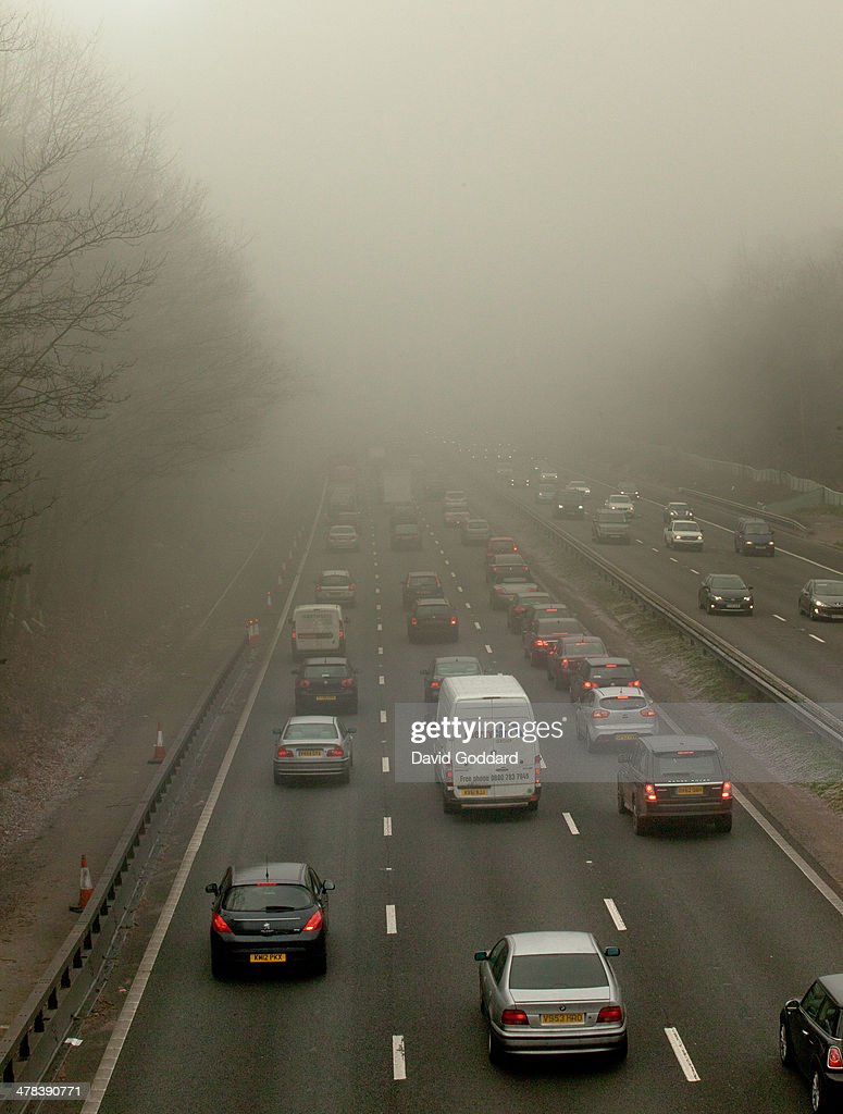 The M3 Motorway at Farnborough, Hampshire as fog brings the rush hour traffic to a standstill on March 13, 2014 in London, England. Thick fog hit much of England and Wales this morning, causing travel disruptions and flight cancellations.