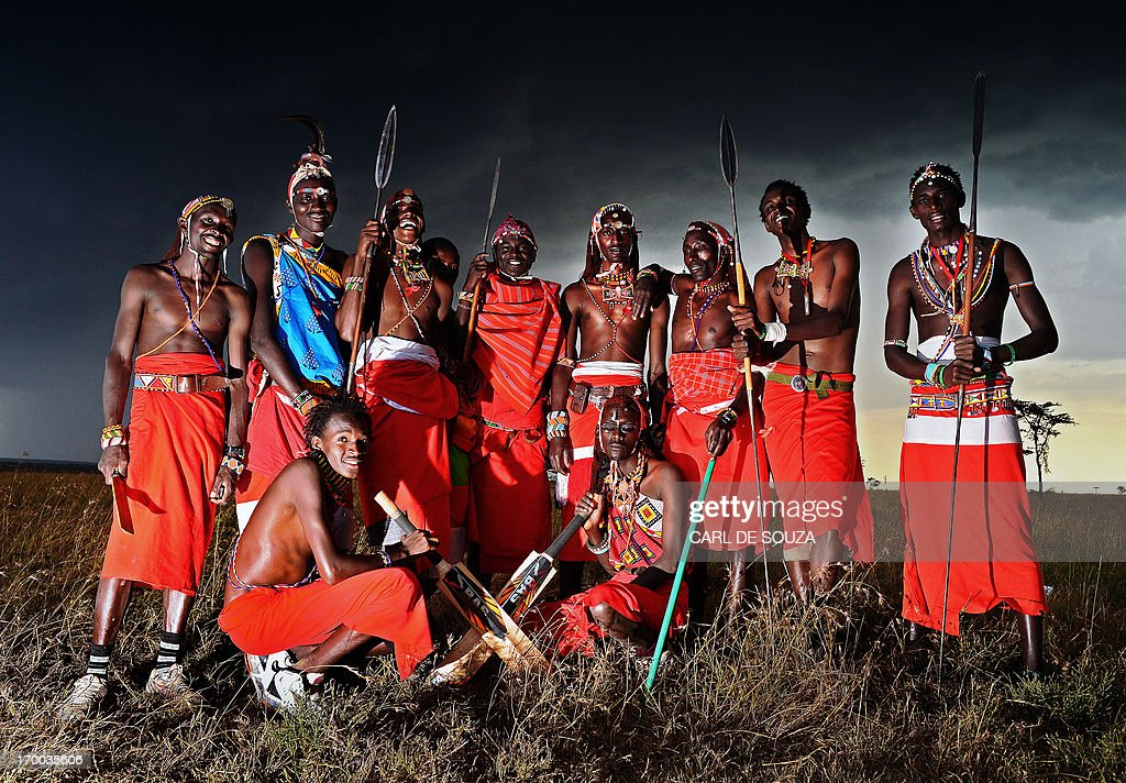 The Maasai Warriors cricket team pose after their Twenty twenty match against an international cricket team, The Ambassadors in Ol Pejeta conservency, Laikipia national park on June 6, 2013. The Maasai Cricket Warriors is a cricket team made up of players from the Maasai tribe, the team play exhibition matches to highlight issues in rural communities including Female Genital Mutilation (FGM) AIDS awareness and poaching. The team are hoping to raise funds through sponsorship to play in the 'Last Man Standing' tournament at Lords Cricket grounds in the UK. AFP PHOTO/Carl de Souza