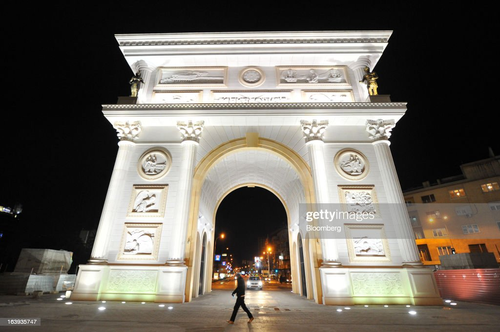 The Macedonian arc de triomphe stands illuminated at night in central Skopje, Macedonia, on Saturday, March 16, 2013. Macedonia's economy contracted by a real 0.3% on the year in 2012, compared to a growth of 2.8% a year earlier, an estimate released by the country's statistics office showed. Photographer: Oliver Bunic/Bloomberg via Getty Images