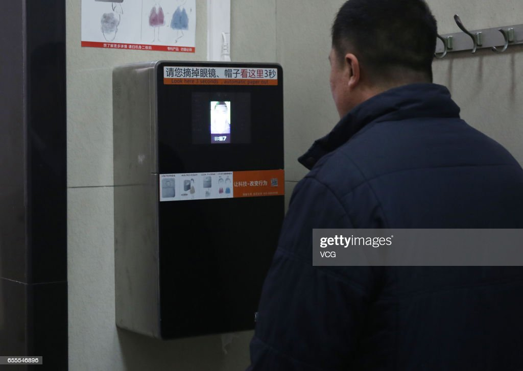 The machine recognizes a man's face to give out toilet paper automatically at a toilet in the park of the Temple of Heaven on March 20, 2017 in Beijing, China. Six toilet roll machines which can recognize one's face to give out paper automatically have been installed at the park of the Temple of Heaven in Beijing. Each person can get 60cm to 70cm toilet paper every time, and can't get twice within 9 minutes.