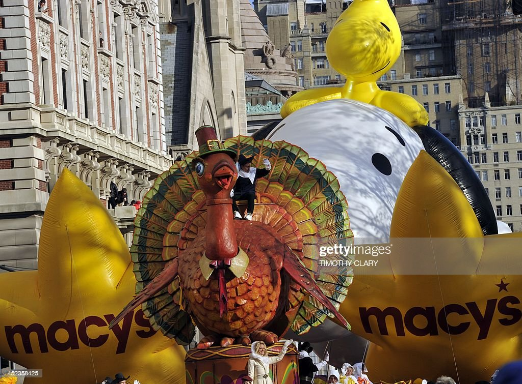 The Macys balloon makes its way down Central Park West during the 87th Macy's Thanksgiving Day Parade in New York on November 28 2013 There was fear...