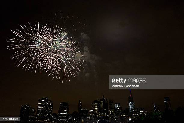 The Macy's Fourth of July Fireworks are seen from Brooklyn Bridge Park on July 4 2015 in the Brooklyn borough of New York City The celebrations mark...