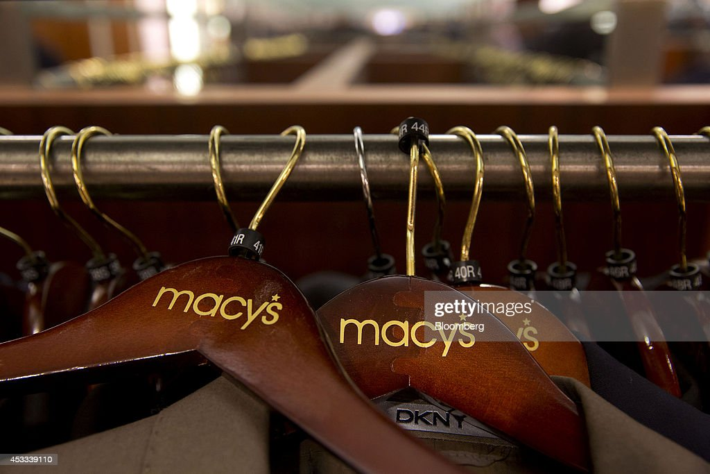 The Macy's Inc logo is seen on clothes hangers at the company's flagship store in New York US on Wednesday Aug 6 2014 Macy's Inc is scheduled to...