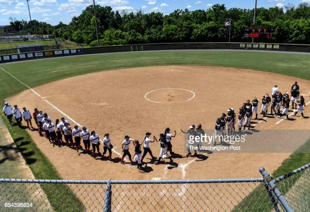 The Madison and Kellam teams meet on the field after playing the Virginia 6A State Softball Semifinal game between Madison and Kellam at Westfield...