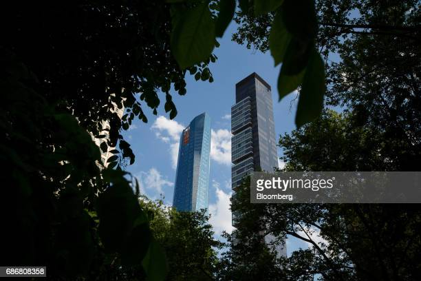 The Madison Square Park Tower left stands next to One Madison Park in the Flatiron District of New York US on Thursday May 18 2017 Madison Square...