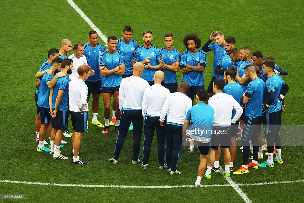 The Madrid squad stand in a huddle to listen to Head coach Zinedine Zidane during a Real Madrid training session on the eve of the UEFA Champions League Final against Atletico de Madrid at Stadio Giuseppe Meazza on May 27, 2016 in Milan, Italy.