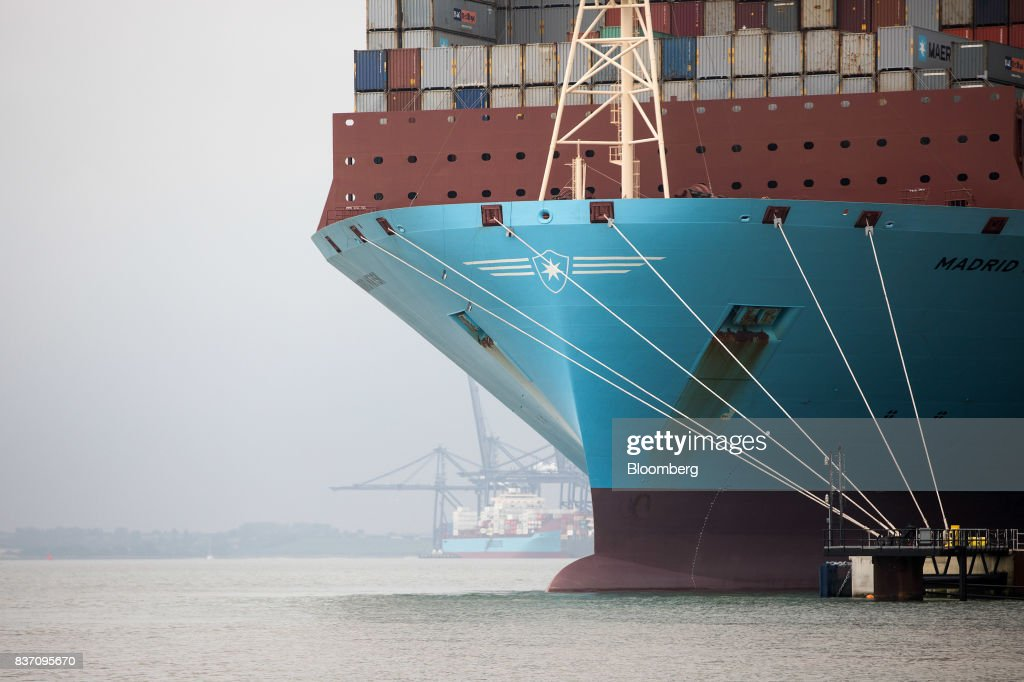 The Maersk Madrid container ship, operated by A.P. Moller-Maersk A/S, sits docked as its cargo is unloaded at the Port of Felixstowe Ltd., a subsidiary of CK Hutchison Holdings Ltd. in Felixstowe, U.K., on Tuesday, Aug. 22, 2017. U.K. exporters are still reaping the benefits of a weaker pound, but they're not sure how long the boost will continue as the country gets closer to withdrawing from the European Union. Photographer: Simon Dawson/Bloomberg via Getty Images