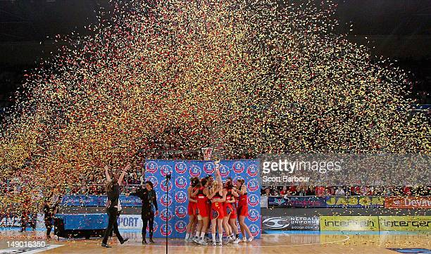 The Magic celebrate with the trophy after winning the ANZ Championship Grand Final match between the Melbourne Vixens and the Waikato Bay of Plenty...