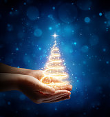 Magic Christmas tree In Child Hands