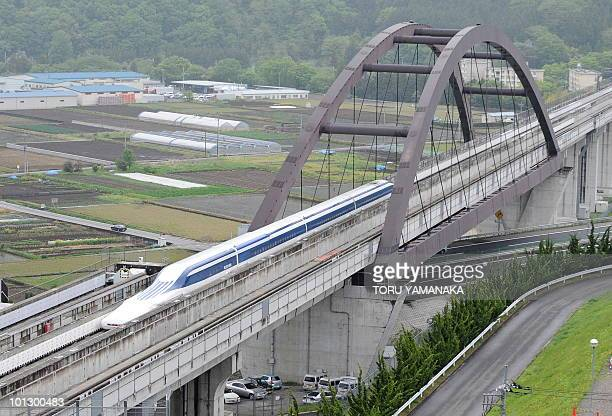 The Maglev train carrying US Transport Secretary Ray LaHood speeds during a test run on the experimental track in Tsuru 100km west of Tokyo on May 11...