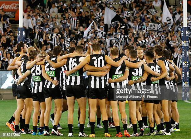 The Magpies huddle before the 2016 AFL Round 02 match between the Collingwood Magpies and the Richmond Tigers at the Melbourne Cricket Ground...