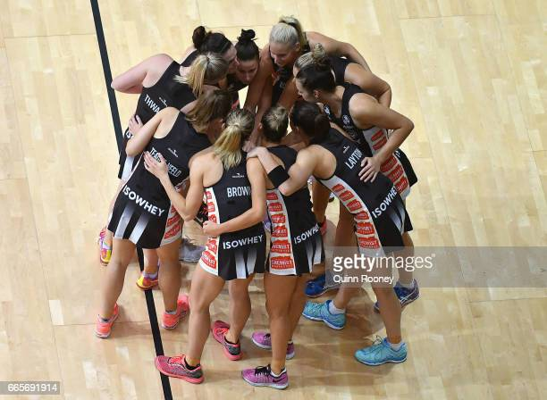 The Magpies huddle together during the round eight Super Netball match between the Magpies and Fever at Hisense Arena on April 7 2017 in Melbourne...