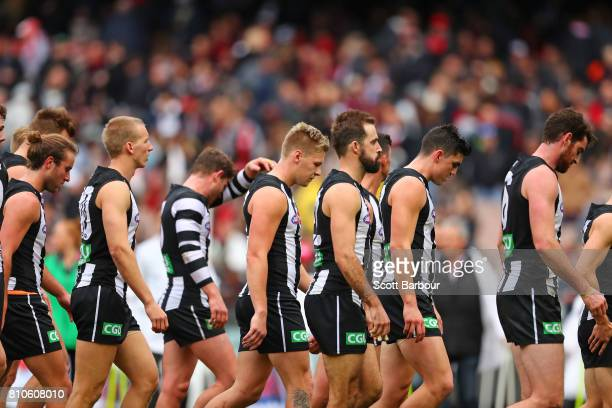 The Magpies leave the field at half time during the round 16 AFL match between the Collingwood Magpies and the Essendon Bombers at Melbourne Cricket...