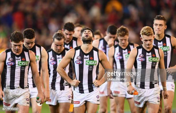 The Magpies look dejected after losing the round five AFL match between the Essendon Bombers and the Collingwood Magpies at Melbourne Cricket Ground...
