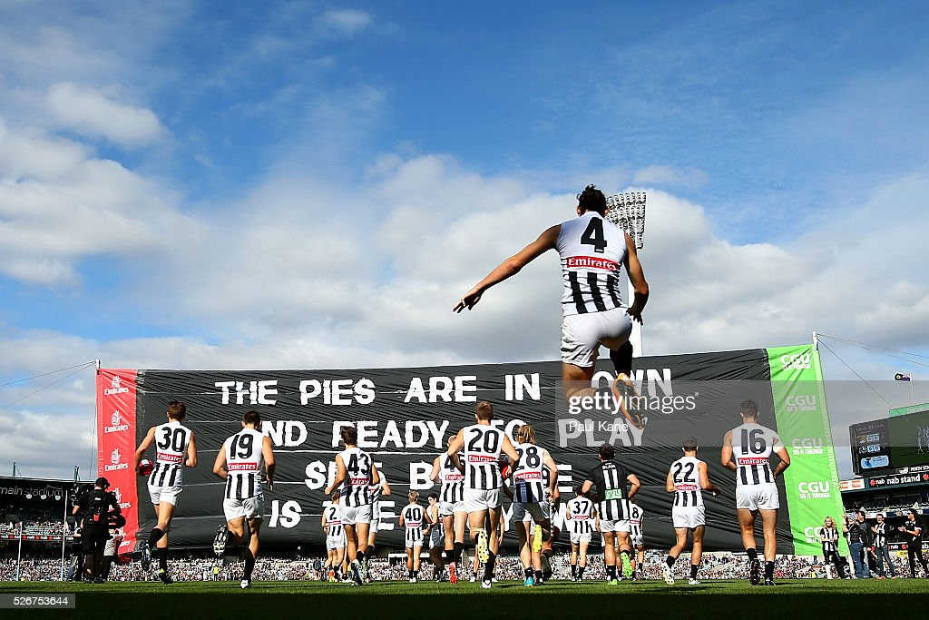The Magpies prepare to run thru their banner during the round six AFL match between the West Coast Eagles and the Collingwood Magpies at Domain Stadium on May 1, 2016 in Perth, Australia.