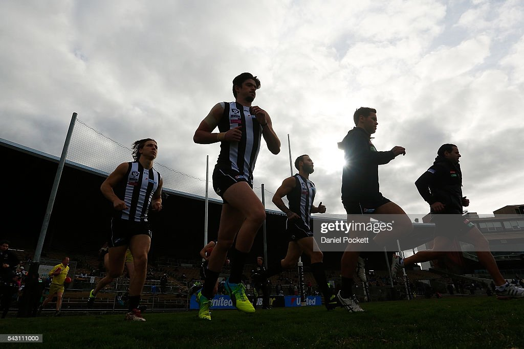 The Magpies run out before the round 12 VFL match between the Collingwood Magpies and the Richmond Tigers at Victoria Park on June 26, 2016 in Melbourne, Australia.