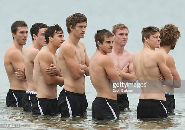 The Magpies wade in the water during a Collingwood Magpies AFL recovery session at St Kilda Sea Baths on May 7 2013 in Melbourne Australia