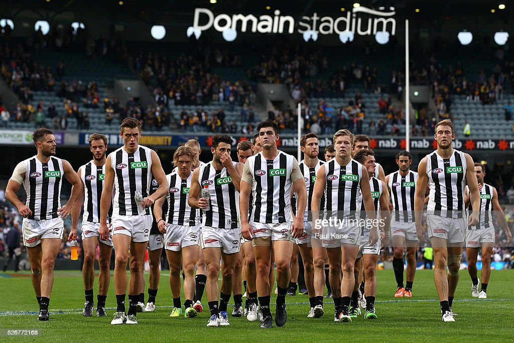 The Magpies walk from the ground after being defeated during the round six AFL match between the West Coast Eagles and the Collingwood Magpies at Domain Stadium on May 1, 2016 in Perth, Australia.