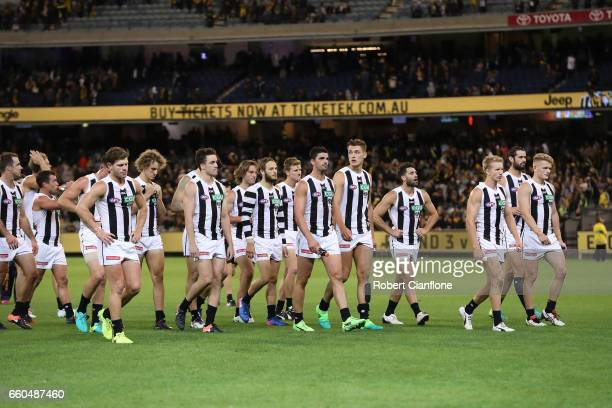 The Magpies walk off the ground after they were defeated by the Tigers during the round two AFL match between the Richmond Tigers and the Collingwood...