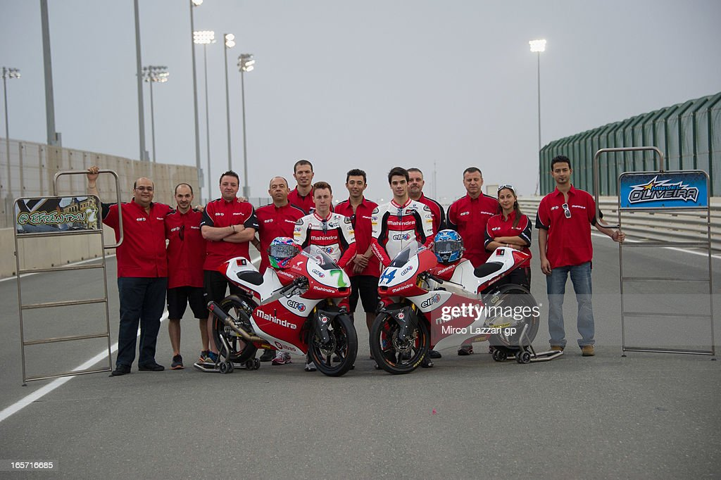 The Mahindra Racing Team pose in pit during the MotoGp of Qatar - Free Practice at Losail Circuit on April 5, 2013 in Doha, Qatar.