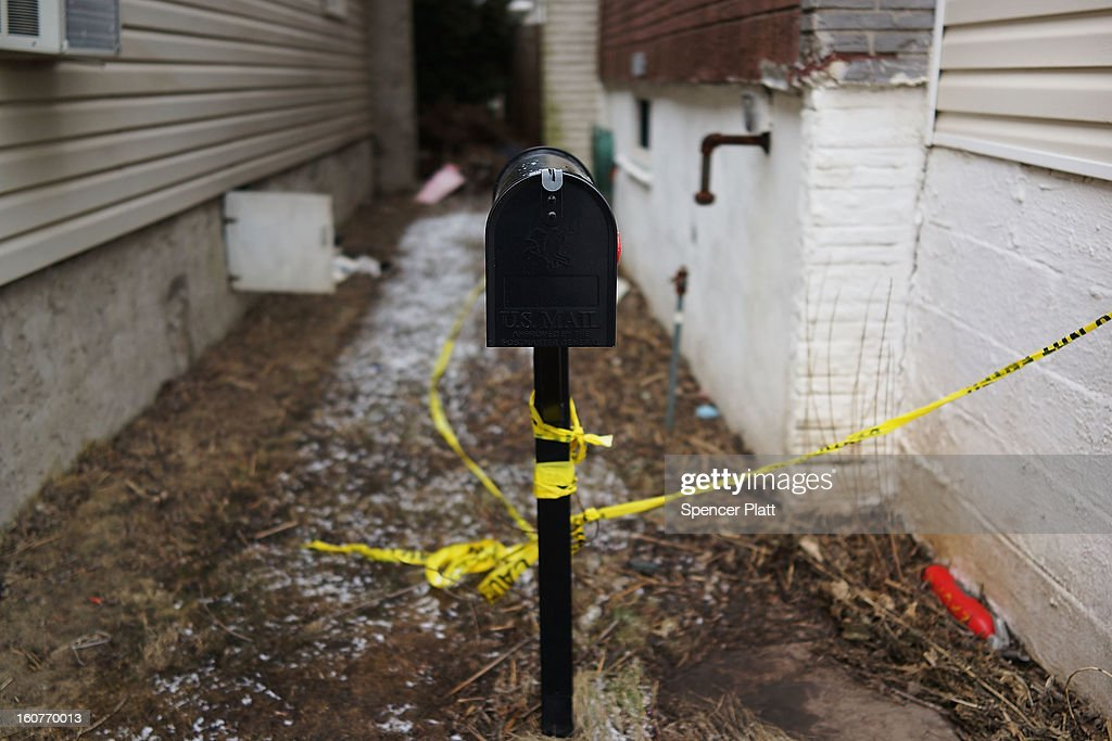 The mailbox of a flood damaged home is viewed in Oakwood Beach in Staten Island on February 5, 2013 in New York City. In a program proposed by New York Governor Andrew Cuomo, New York state could spend up to $400 million to buy out home owners whose properties were destroyed by Superstorm Sandy. The $50.5 billion disaster relief package, which was passed by Congress last month, would be used to fund the program. If the program is adopted, homeowners would be relocated and their land would be left as a natural barrier to help absorb future floods waters.