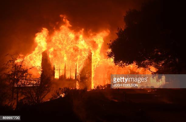 TOPSHOT The main building at Paras Vinyards burns in the Mount Veeder area of Napa in California on October 10 2017 Firefighters battled wildfires in...