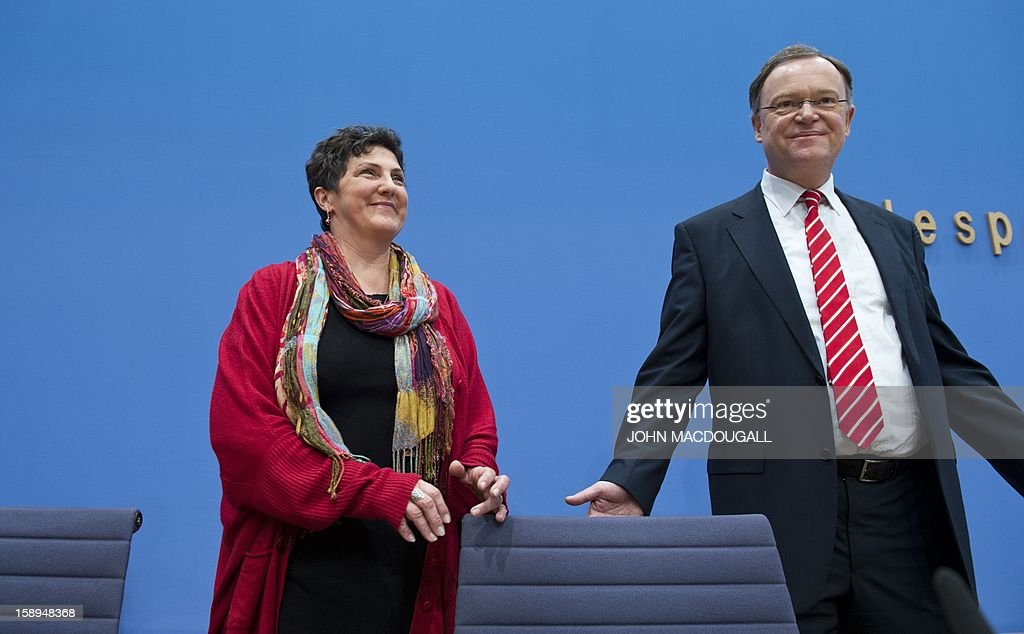 The main candidate for the Green Party in upcoming regional elections in Lower Saxony Anja Piel (L) and the main candidate for the Social Democratic Party (SPD) Stephan Weil, pose for photographers at the start of a press conference in Berlin on January 4, 2013. Lower Saxony goes to the polls January 20, 2013, with a Green Party/SPD coalition hoping to replace the current Christian Democratic Union (CDU) and Liberals (FDP) coalition.
