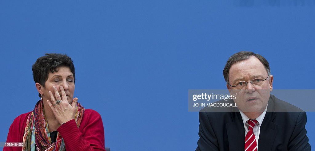 The main candidate for the Green Party in upcoming regional elections in Lower Saxony Anja Piel (L) and the main candidate for the Social Democratic Party (SPD) Stephan Weil, address a press conference in Berlin on January 4, 2013. Lower Saxony goes to the polls January 20, 2013, with a Green Party/SPD coalition hoping to replace the current Christian Democratic Union (CDU) and Liberals (FDP) coalition.