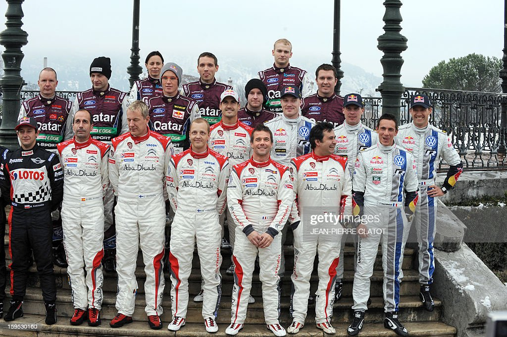 The main contenders of the World Rally Championships, title holder Sebastien Loeb (first row, C) and his co-pilot Daniel Elena (first row, 2ndR) Finland's Mikko Hirvonen (first row, 4thL), France's Sebastien Ogier (R) and his co-pilot Julien Ingrassia (2ndR), Spain's Dani Sordo (second row C) Finland's Jari-Matti Latvala (second row, 3rdR) and Norway's Mat Ostberg (third row,3rdR) pose on January 15, 2013 in Valence, at Monte Carlo Rally's parc ferme, on the eve of its start. The Monte Carlo Rally kicks of the 2013 season which will see a new world champion crowned for the first time since 2003 as Loeb races a limited season after a record nine straight titles. AFP PHOTO / Jean Pierre Clatot