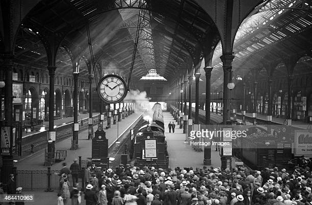 The main engine shed at Liverpool Street Station London circa 1930 A crowd of passengers wait to board the Felixstowe train which is standing on...