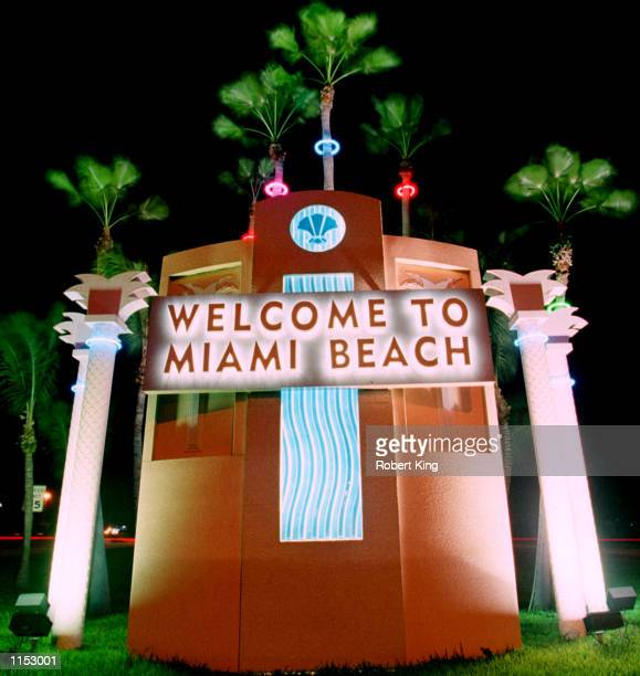 The main entrance to South Beach on interstate 195 has an Art Deco welcoming sign that is illuminated by colorful lights during the night October 1...